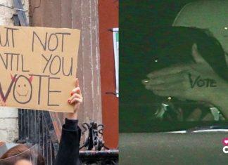 Dos mensajes invitando al voto, uno es un cartel y el otro está pintado en una mano